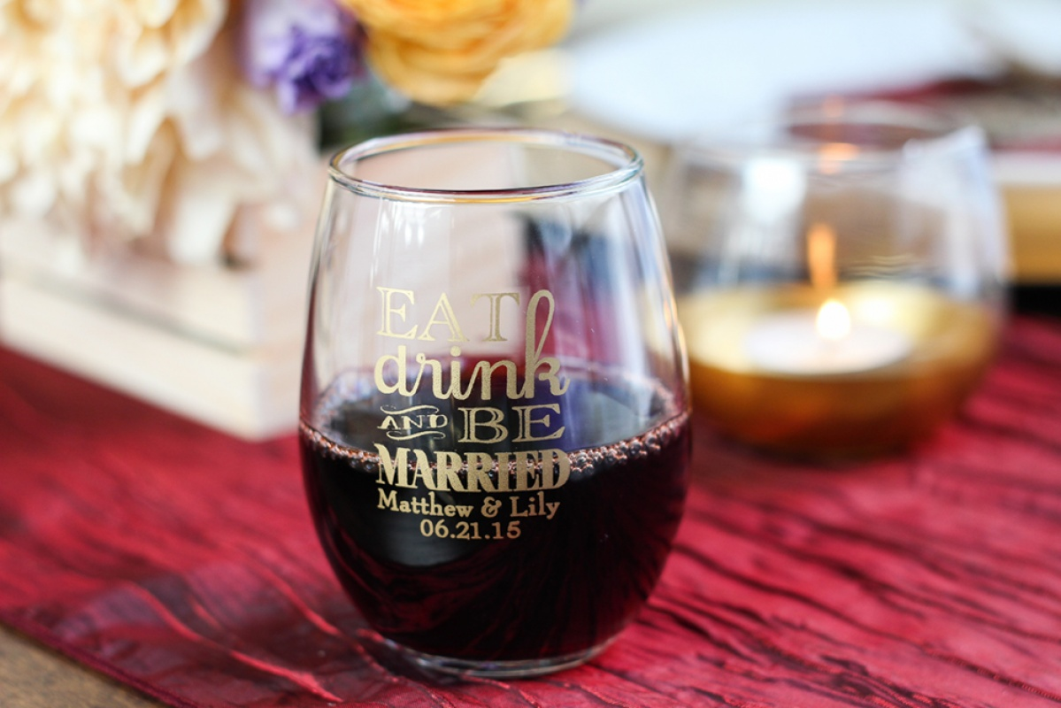 Eat, drink, and be married personalized stemless wine glass with red wine for a vineyard or wine wedding.