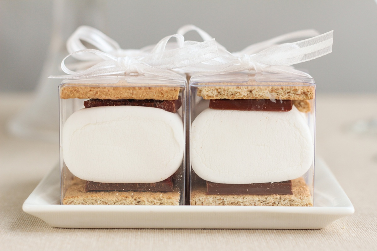 Smores favor in a clear acrylic box with a white box.