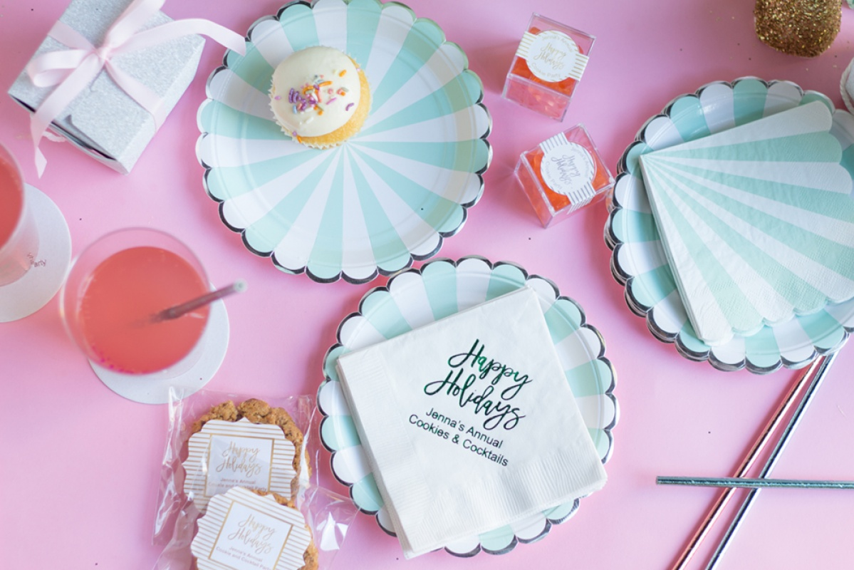 Aqua scalloped plates, personalized holiday napkins and cookies for a kitsch Christmas.