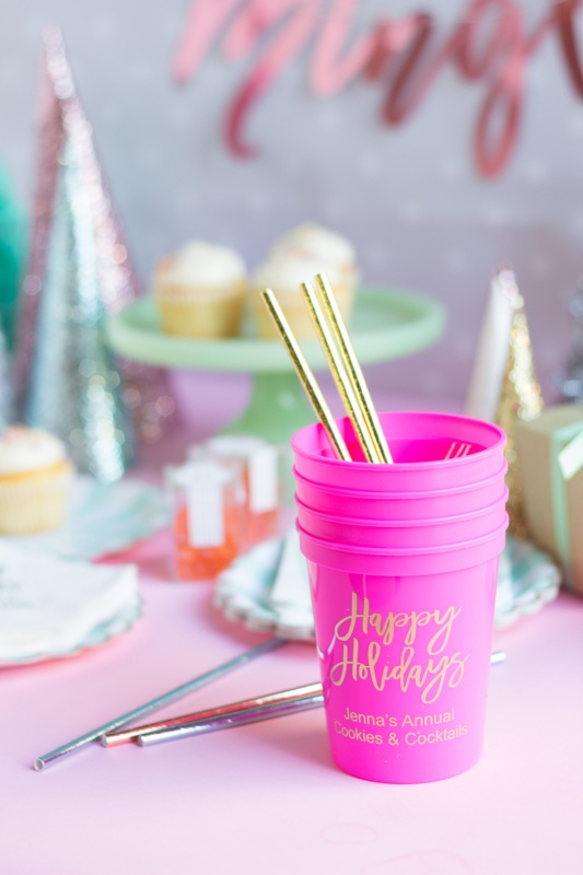Pink Christmas cups with gold straws for a kitsch Christmas.