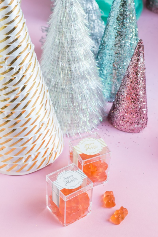 Sparkly cone Christmas trees with champagne gummy bears for a pink Christmas or kitsch Christmas.