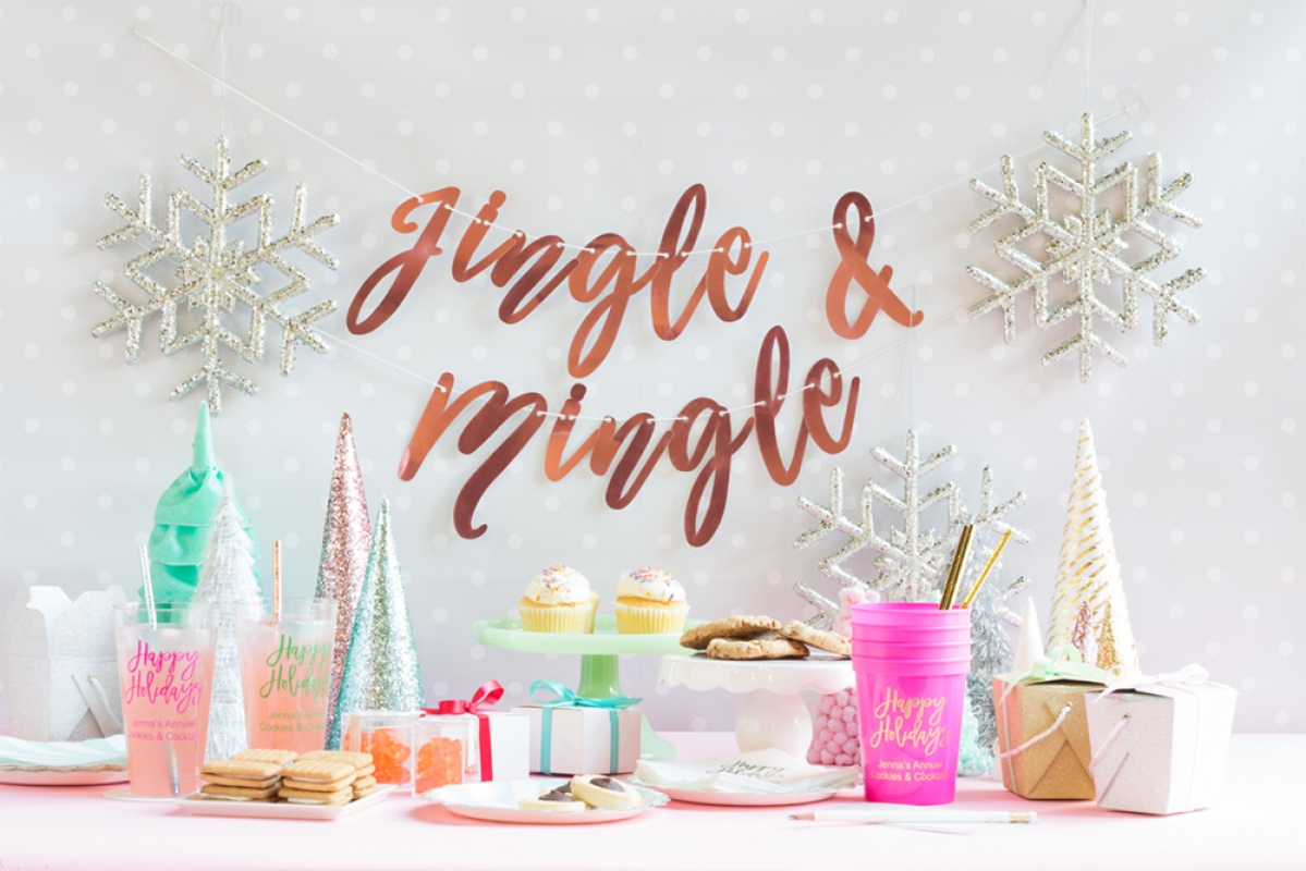 A kitsch Christmas party with glitter Christmas trees, cookies, snowflakes, and aqua and pink Christmas details.