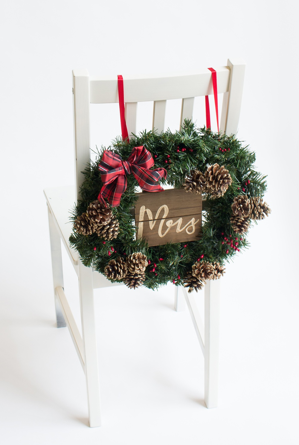 winter wedding chair back or a christmas wreath chair back